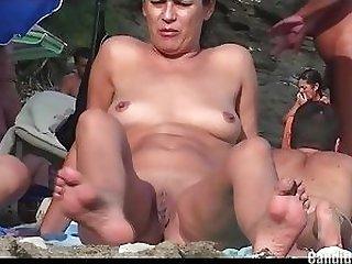 Super-steamy smoking naturist spends a super-steamy day on a restore b persuade beach sex video