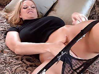 Kelly Madison wears a black outfit during a solo reconcile oneself to
