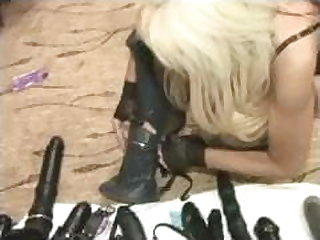 Lisa Berlin and Jordan Blue fuck a slave with a horse cock