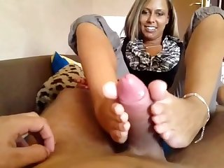 Gorgeous German blonde gives a superb footjob and gets cum on her sensational feet