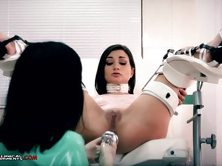 Crazy nurse, Minerva is toying with Valentina Bianco, while they are alone in the office