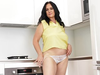 Chubby mature slut Ria Black enjoys masturbating in the kitchen