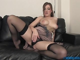 Adorable chick Cate Harrington with stockings plays with her pussy